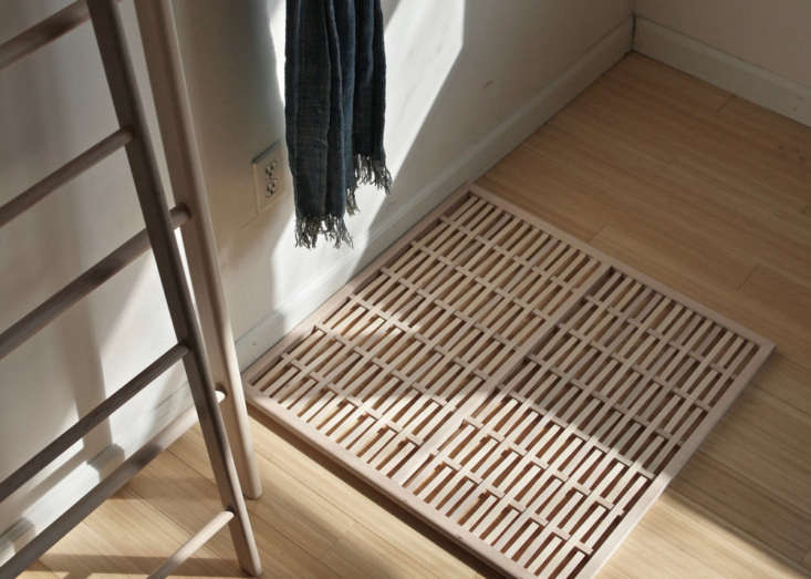 A woven mat in maple.