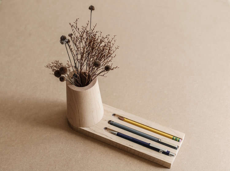 A maple Pencil Tray, with attached vessel for dried flowers.
