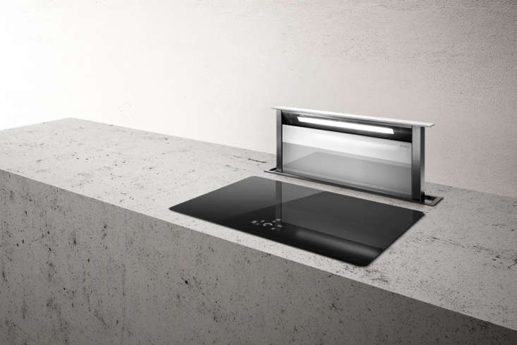 The Adagio Vista Downdraft Range Vent from Elica has a touch control interface and comes in stainless steel, black, or white glass. Contact Elica for price and ordering information.