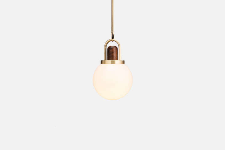 The Allied Maker Arc Globe 08-Inch Pendant in Brass and Black Walnut is $950 at Allied Maker.