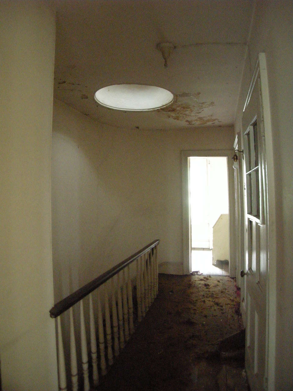 The top floor hall with skylight and banister that&#8