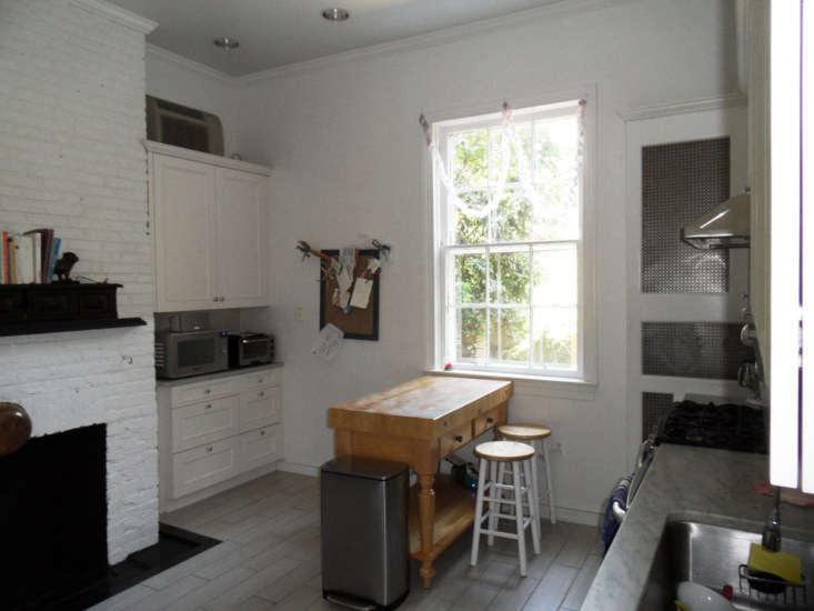 All of the appliances were on show, and the kitchen was dominated by a large brick hearth—&#8