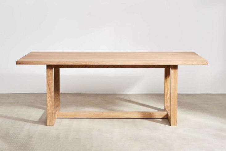 The Bailey Dining Table designed by Peter Lowe is available in an 8- or -seat size starting at £