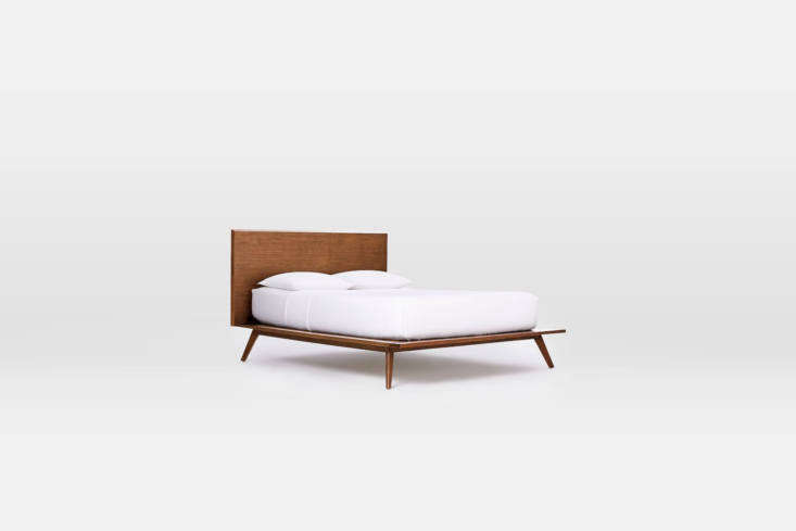 A similar midcentury style bed frame is the Mid-Century Platform Bed in walnut; $loading=
