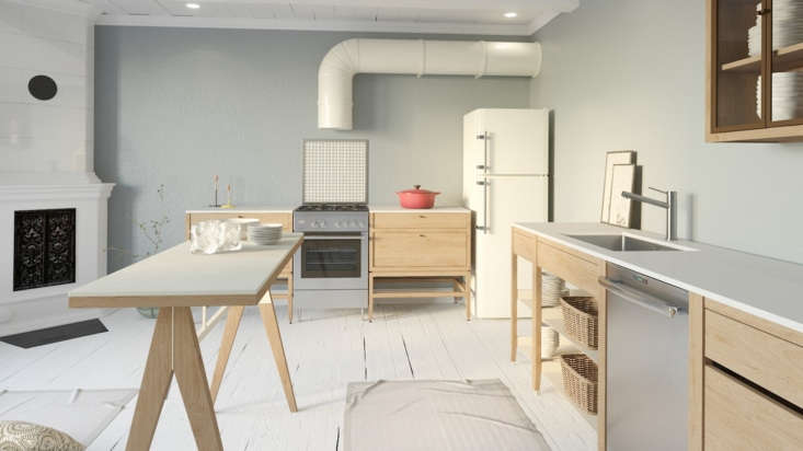 A Scandi-style kitchen with Coquo furnishings—including Volitare Cabinets (flanking the range), open-shelved Radix Cabinets (at right; from $loading=