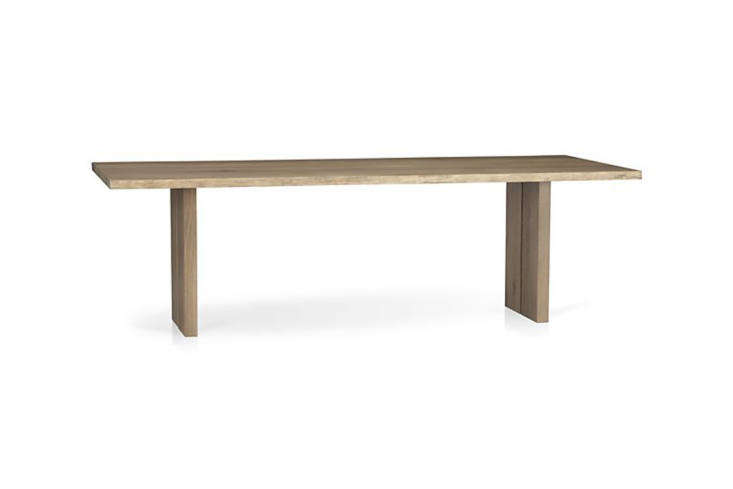 The dining table is from Crate & Barrel, now discontinued. Something similar is the Crate & Barrel Dakota Dining Table in European white oak; $loading=