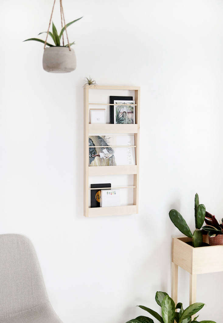 Manda created the DIY Wood Wall Organizer in response to her kids&#8