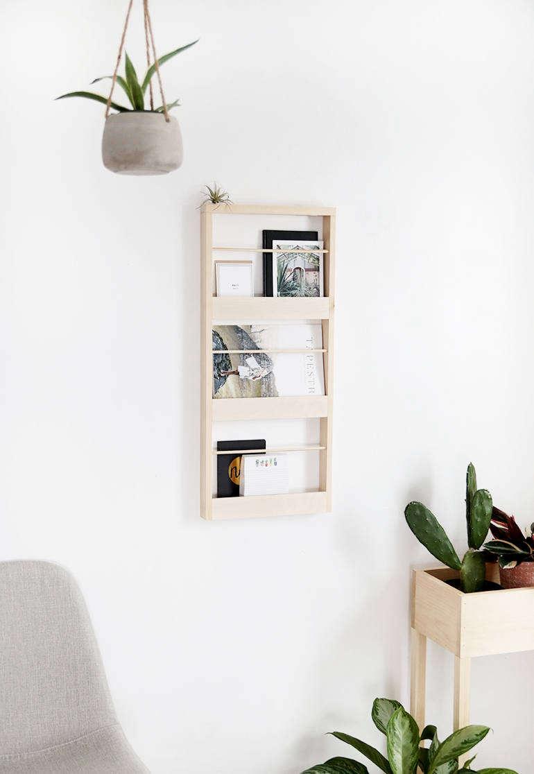 Manda created the DIY Wood Wall Organizerin response to her kids&#8