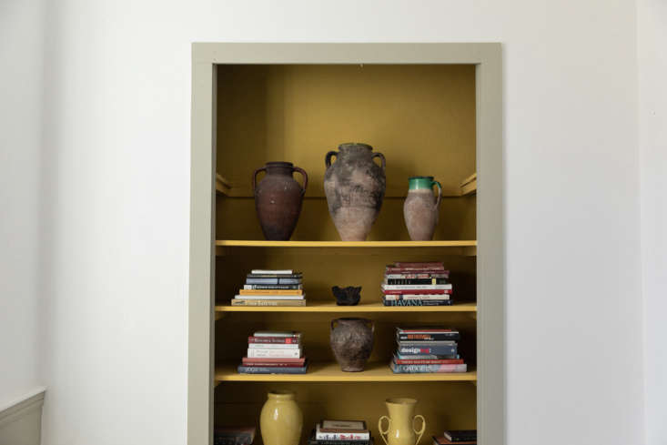 McNeil painted the interior of an open closet a surprising butter yellow.