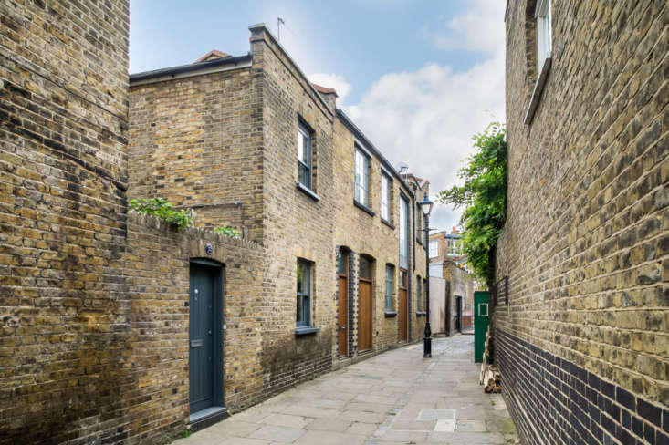 The house, tucked behind the blue door, was originally the storeroom for the bakery next door, now converted into two apartments. It&#8