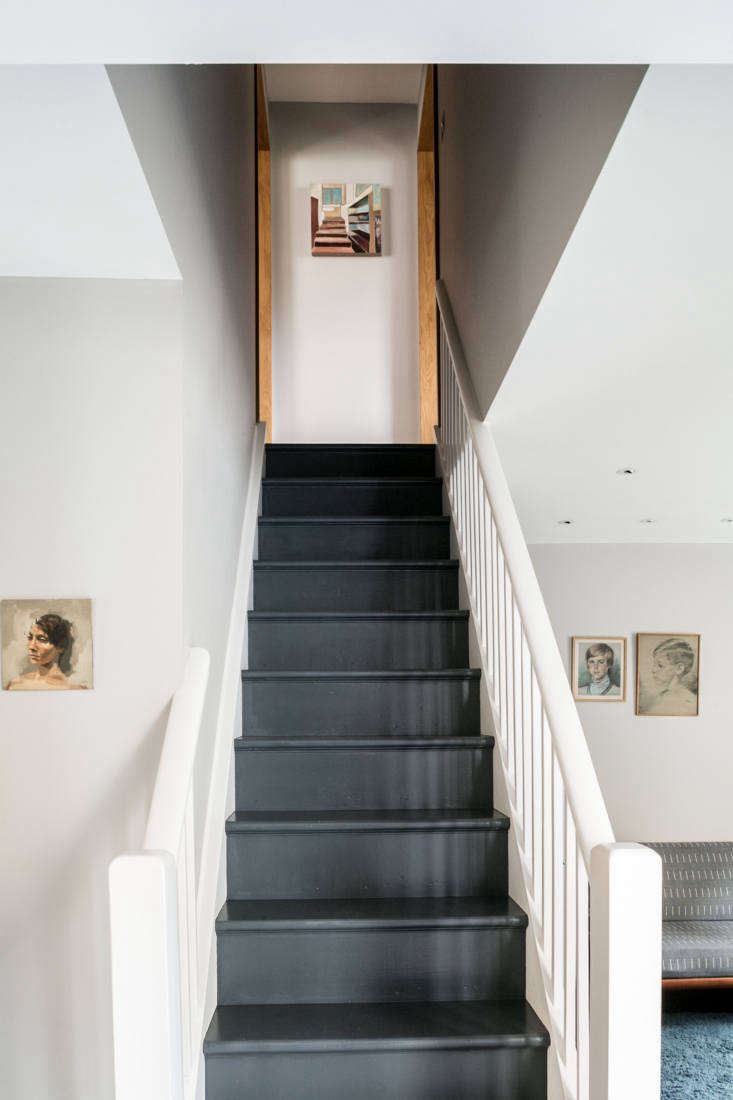 The walls throughout are painted French Grey from Little Greene, and the existing stairs were stripped and refinished with a dark gray floor paint.