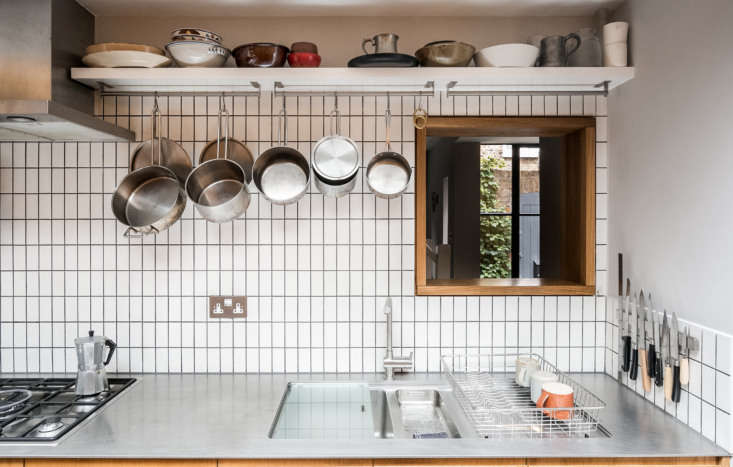 The kitchen has 4-millimeter-thick stainless-steel counters and an inset sink-and-a-half with incorporated drying area—all sourced from an industrial kitchen supplier.