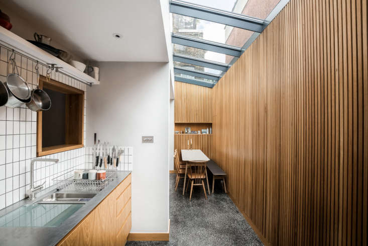 The continuous skylight runs from the dining room to the adjacent kitchen. The window above the sink overlooks the entry and living area. The interior is 658 square feet.