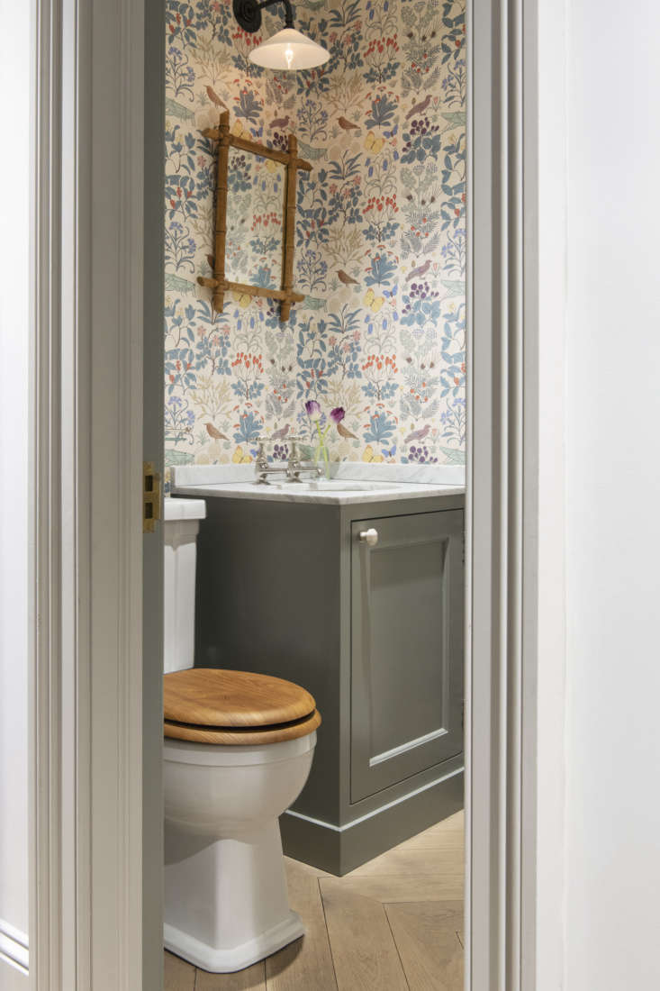 the powder room is papered in cfa voysey&#8\2\17;s \19\26 pattern apothecar 21