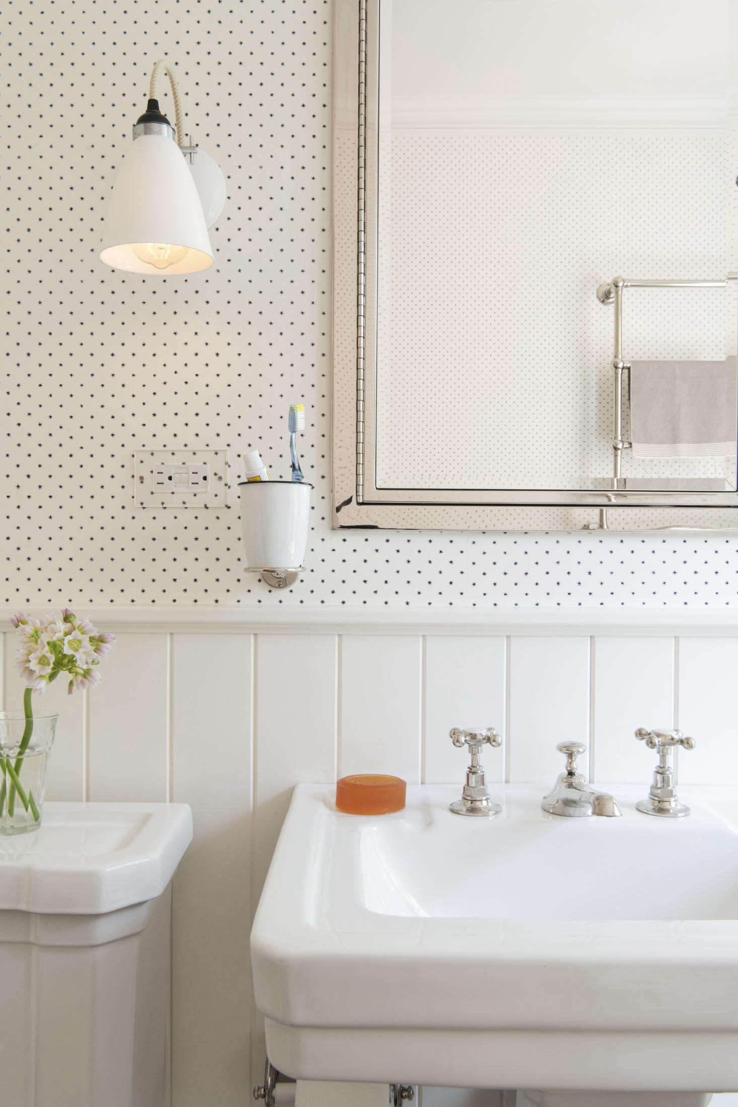 The room is papered with Lee, a tiny star pattern from Hinson. The pedestal sink is the Richmond from St. Thomas Creations. The nickel faucets are Barber Wilsons—part of the owners order placed in London.