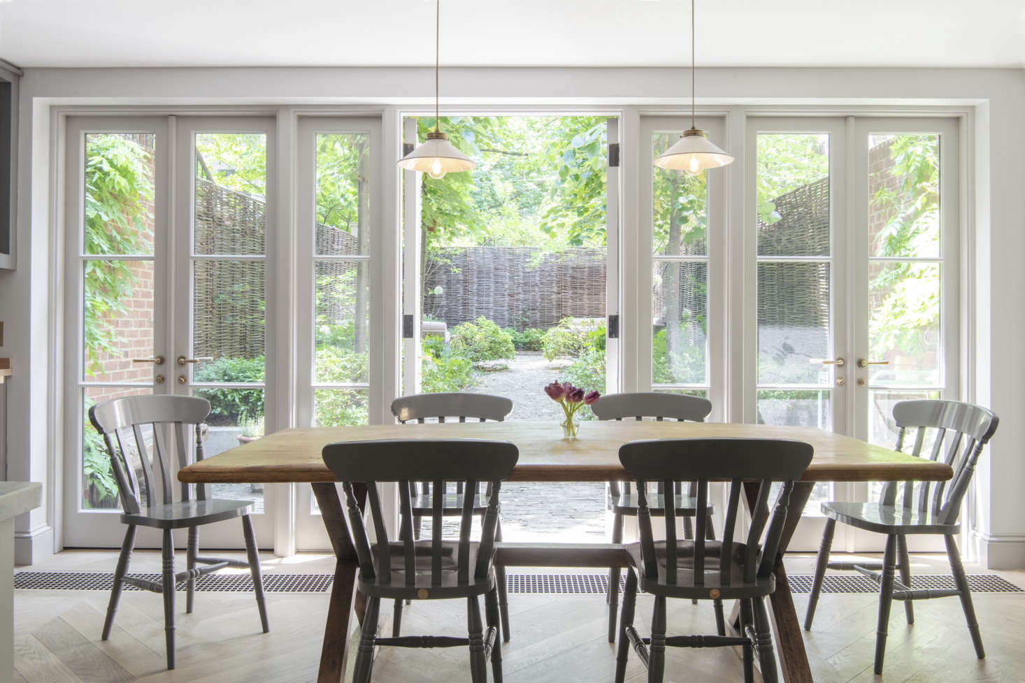 The owners decided to keep the kitchen in its original location because they like the link to the garden—&#8