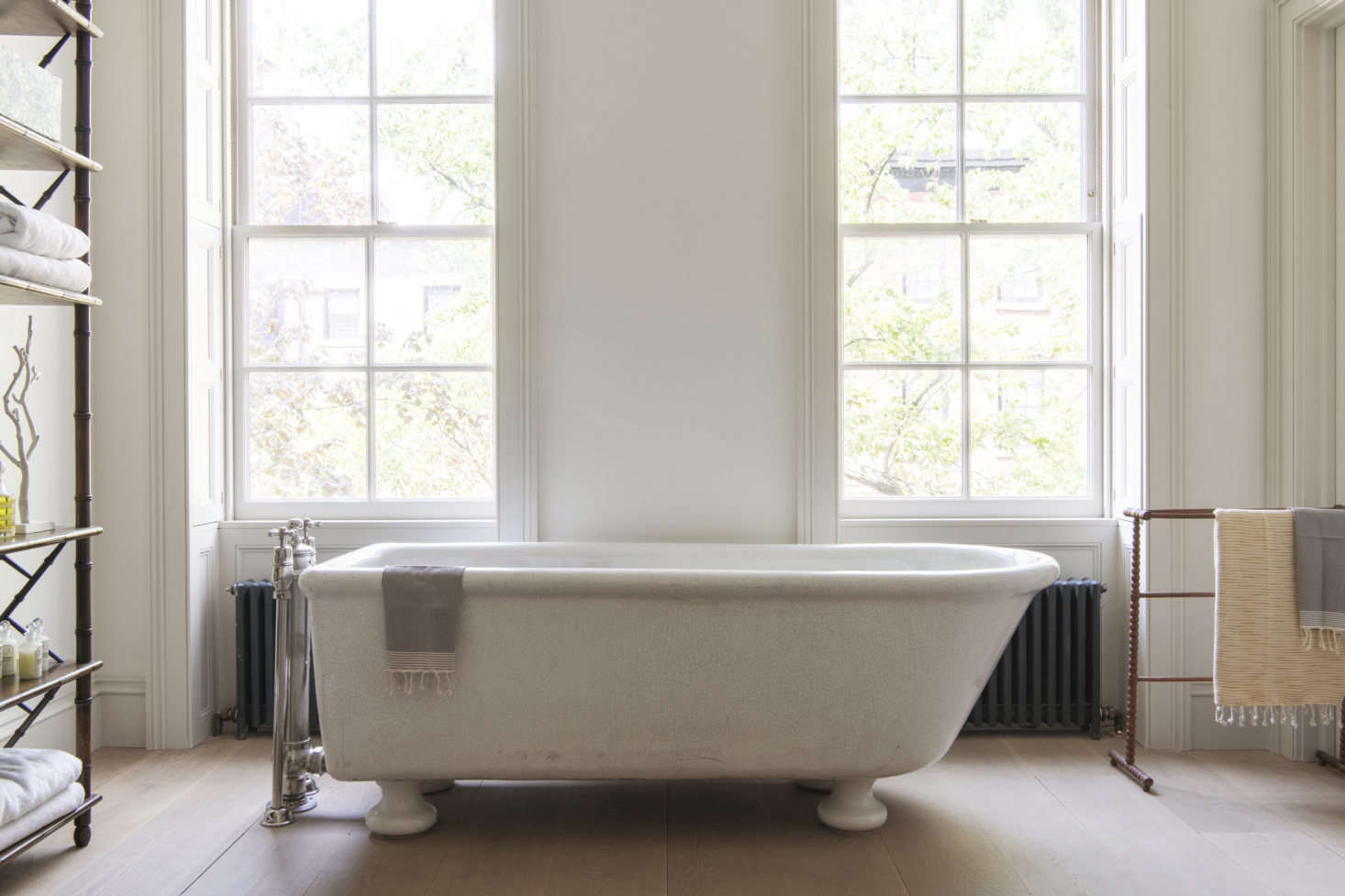 The master bath—which doubles as a study—features a six-foot-plus antique tub: mother and children can all fit in.