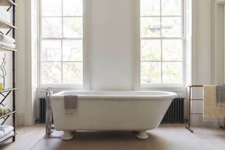 the master bath—which doubles as a study—features a six foot plus antique t 27
