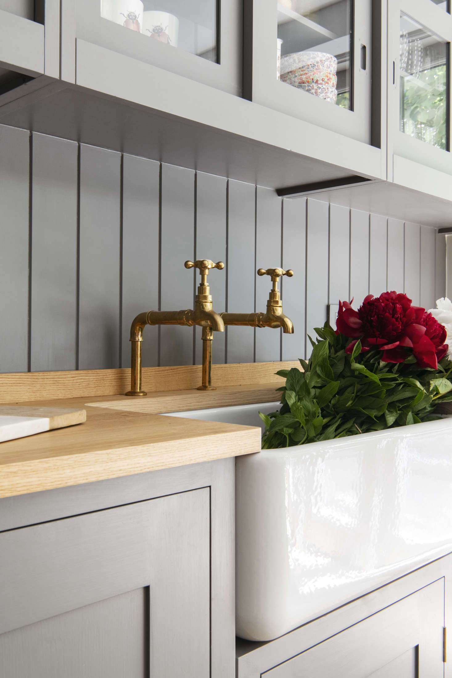 Barber Wilsons hot and cold taps in unlacquered brass and a Shaws Original farmhouse sink.The counter is Plain English oak butcher block.