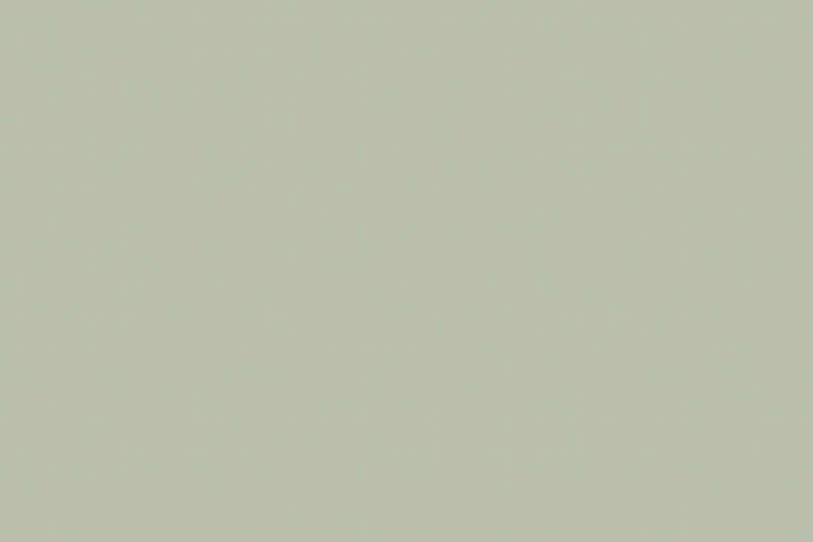 The Farrow & Ball Pigeonpaint color is painted on the kitchen cabinets.
