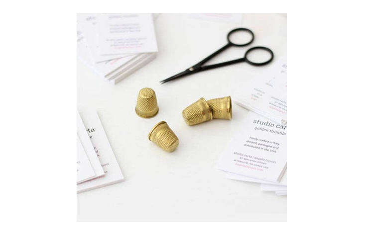 Something special for the seamstress in your life, Gold Thimbles are plated in K gold. Imported from Italy by Studio Carta; $6 each.
