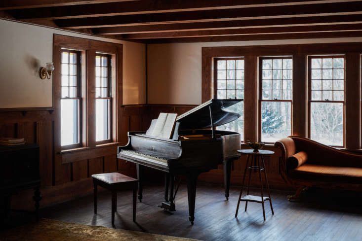 A baby grand piano anchors a corner of the ballroom, where the children of the house host impromptu dance parties. &#8