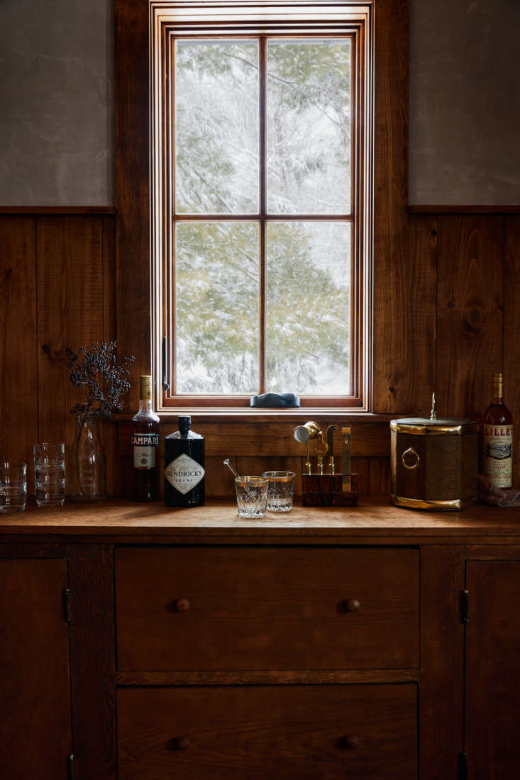 Though it looks original to the house, the bar in the groom&#8