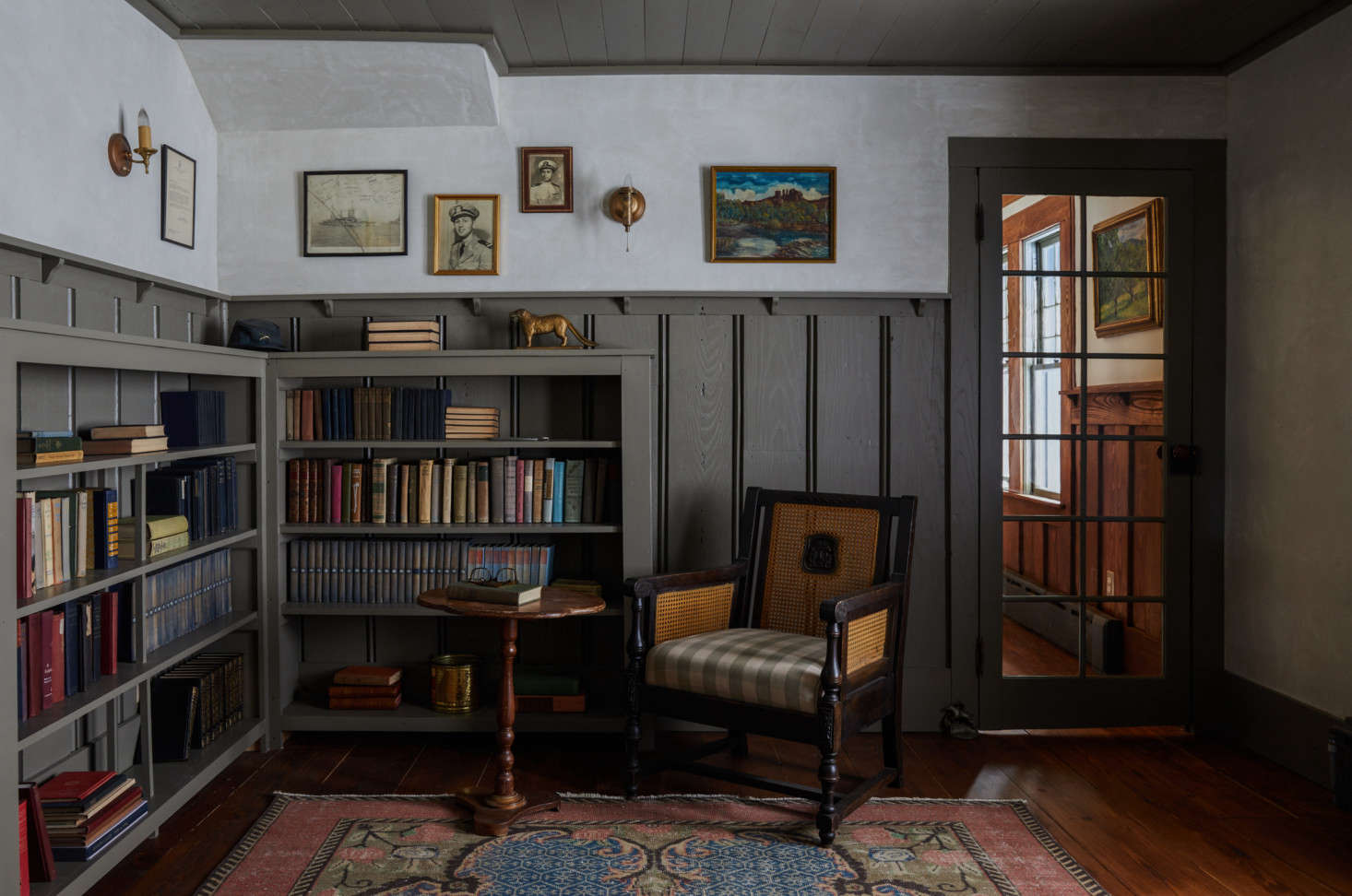 When the couple purchased the home, they found many bits of ephemera, including old photos and books that now occupy the home&#8