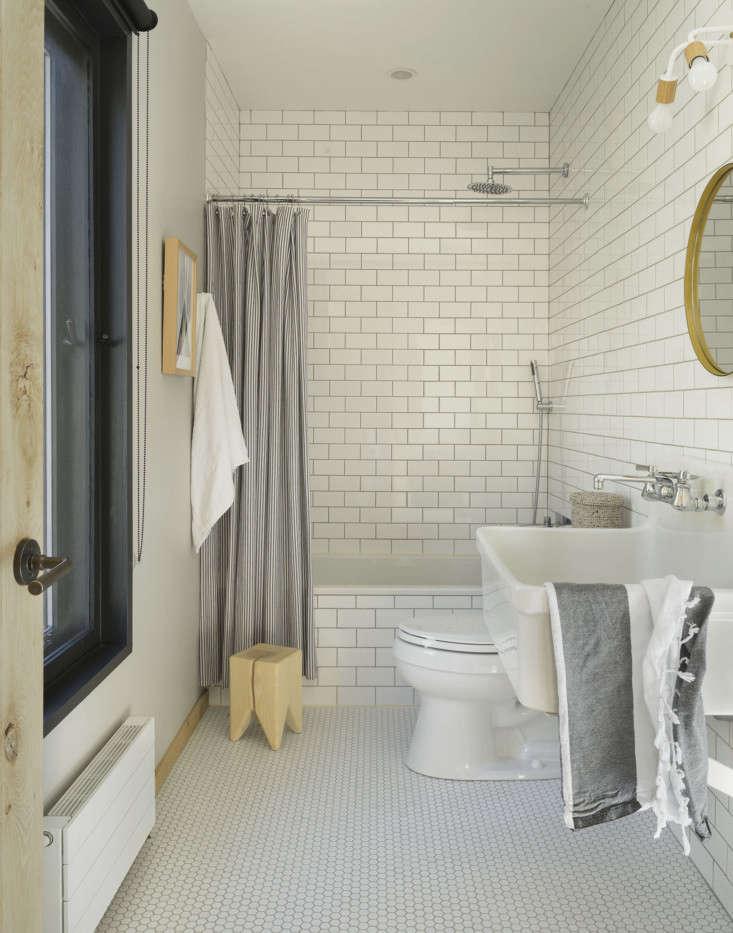 matilda&#8\2\17;s tiled bathroom featuresa kohler sink, lighting by onefo 15