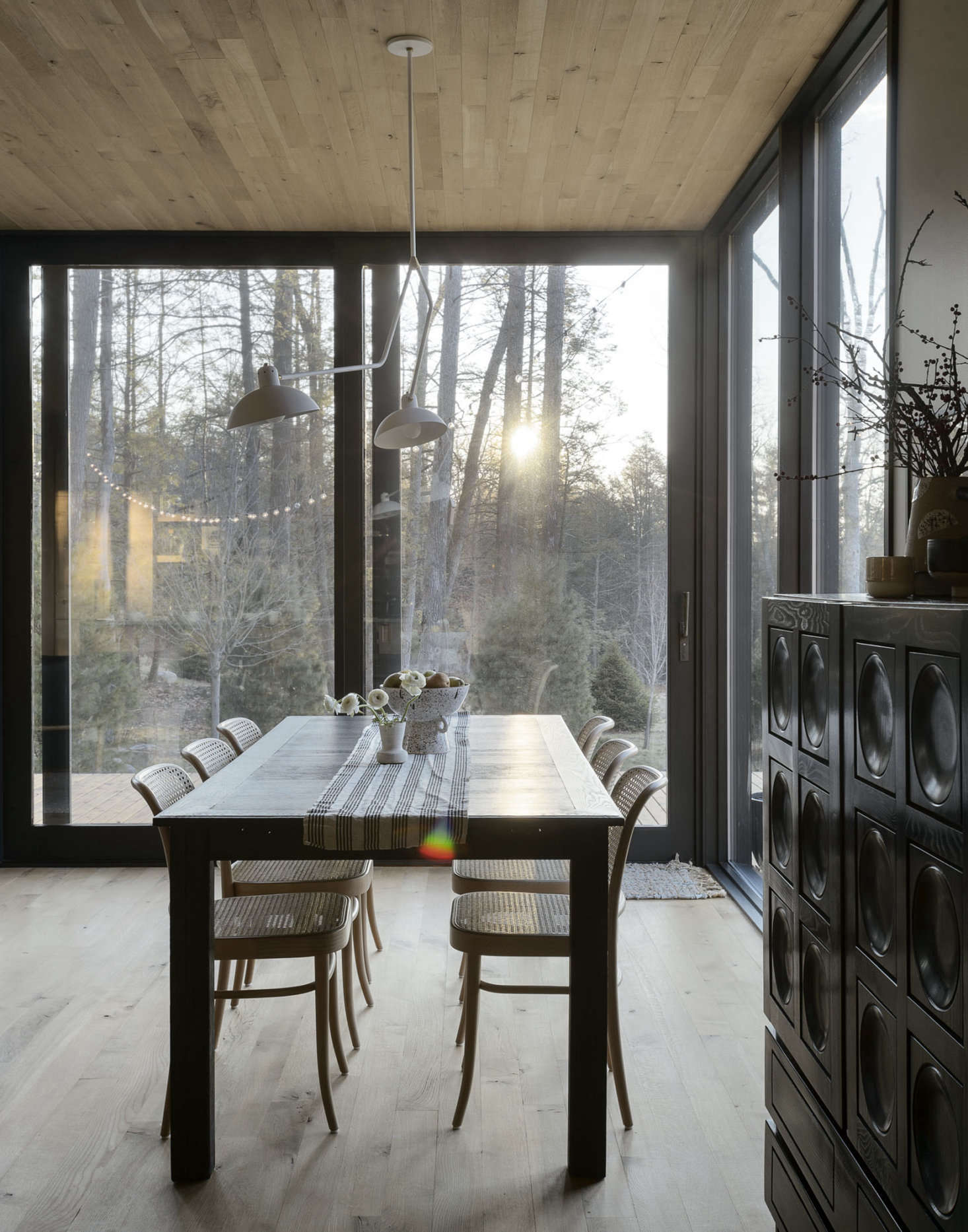 Floor-to-ceiling windows in much of the open living space put the focus squarely on the outdoors. &#8