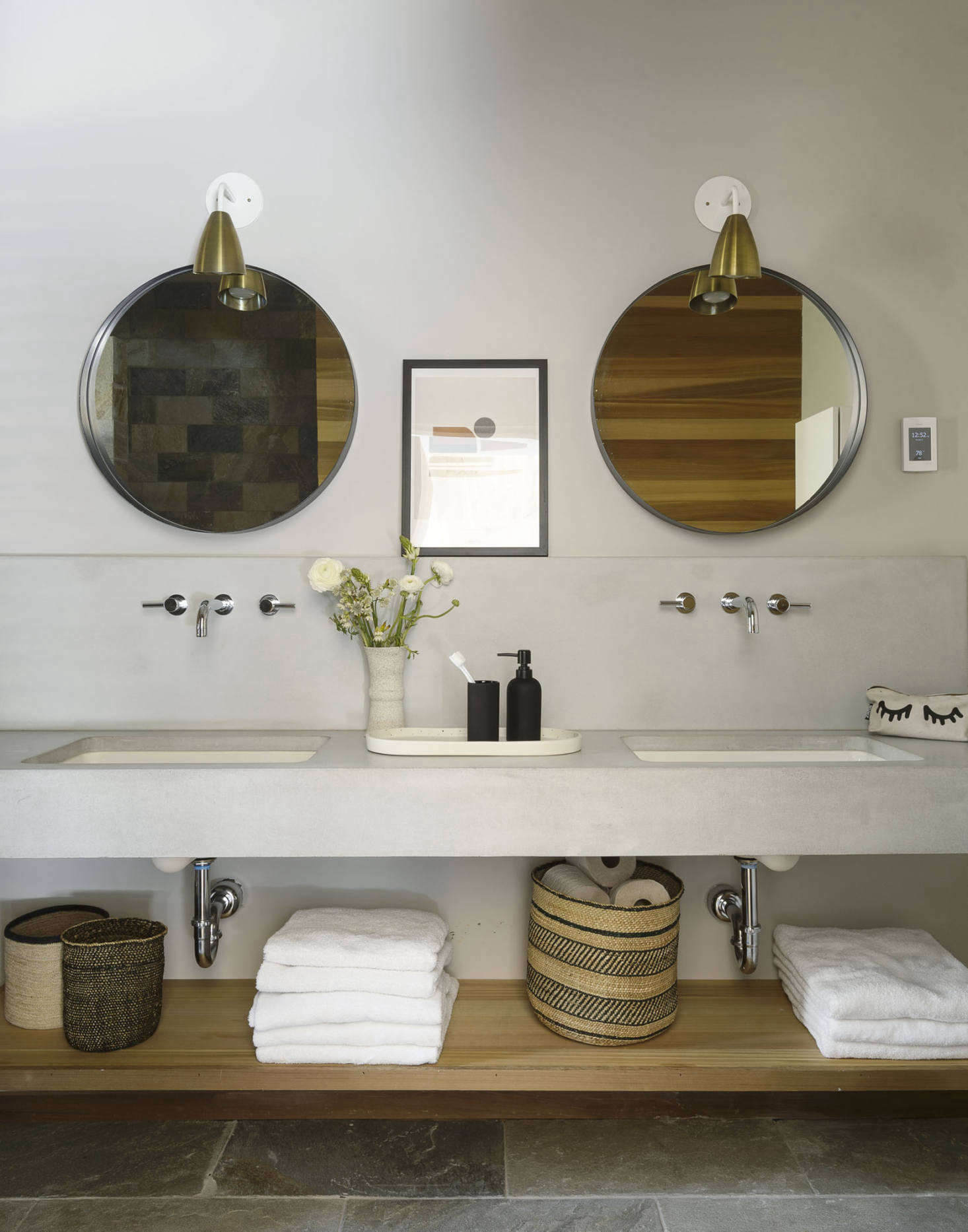 The double sink in the master bath was custom-made using fiber-reinforced concrete.