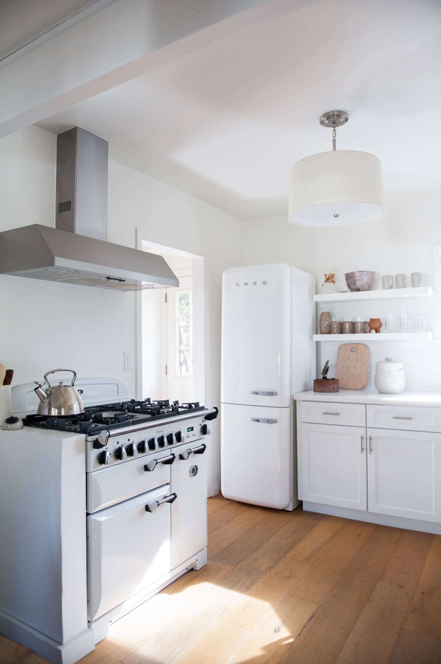 Wire-brushed, engineered wide-plank oak floorboards replaced the kitchen&#8