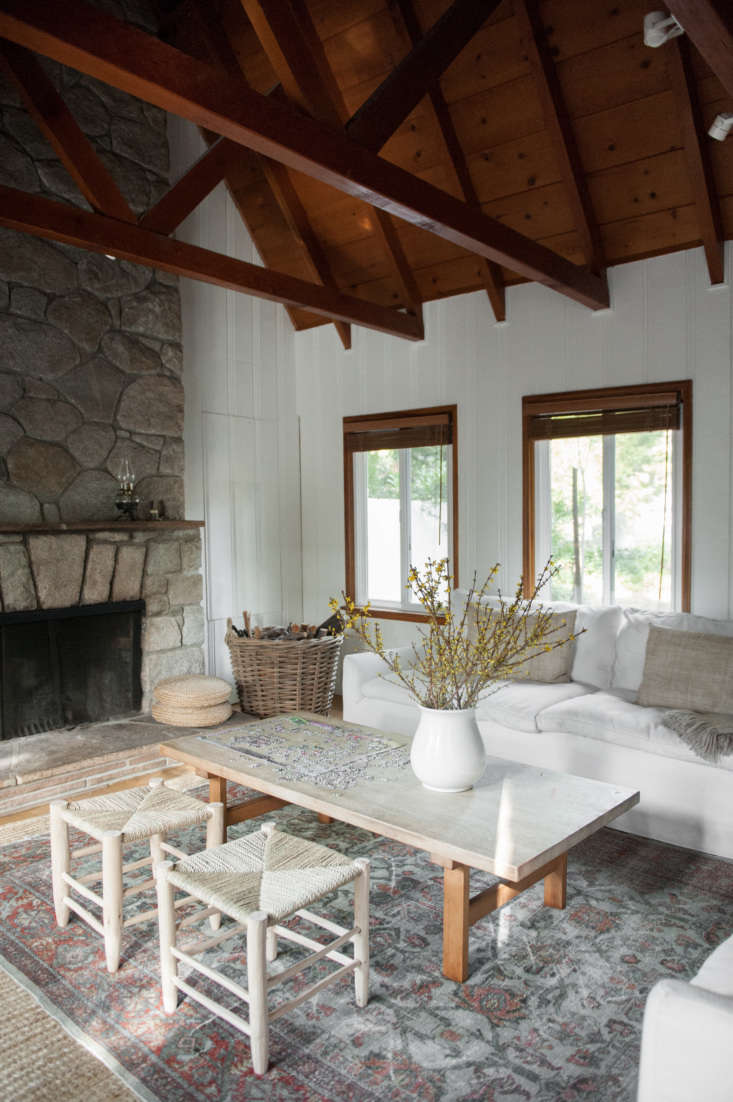 the stone fireplace is original and gets put to use year round. lauren placed a 10