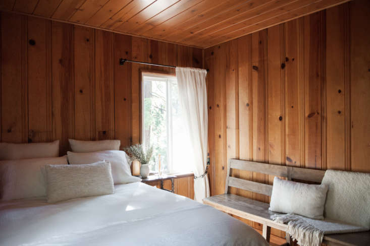 the paneling in the bedrooms was also left natural butsanded to mute its varn 18