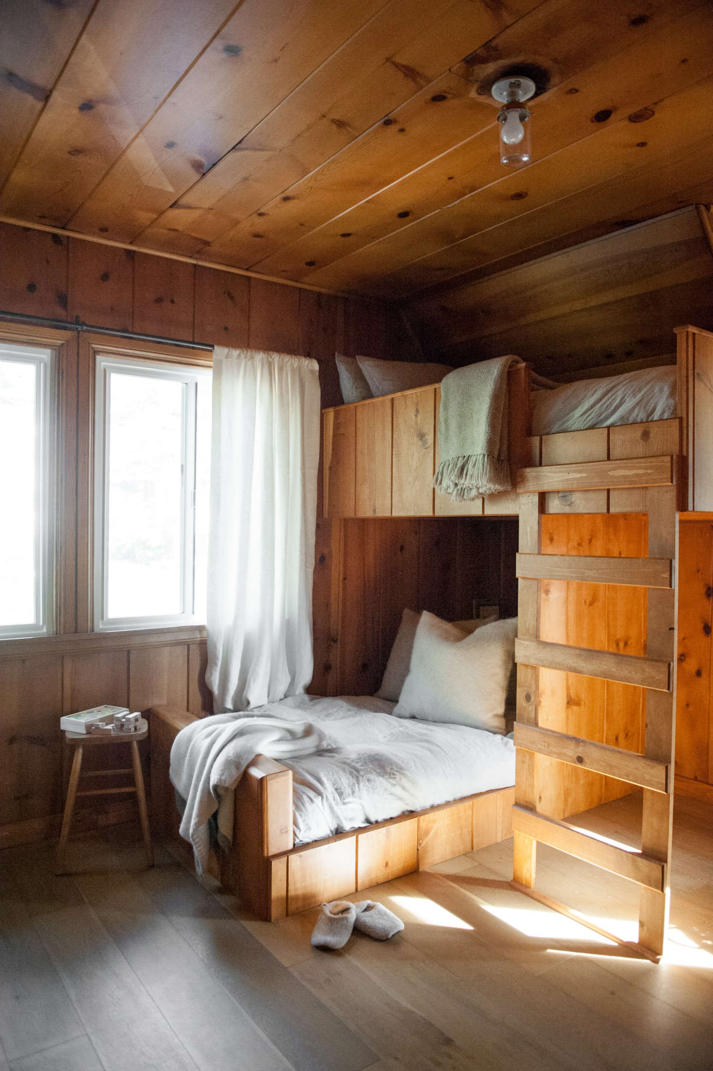 Lauren designed the custom bunk beds to continue the lines of the existing paneling.&#8