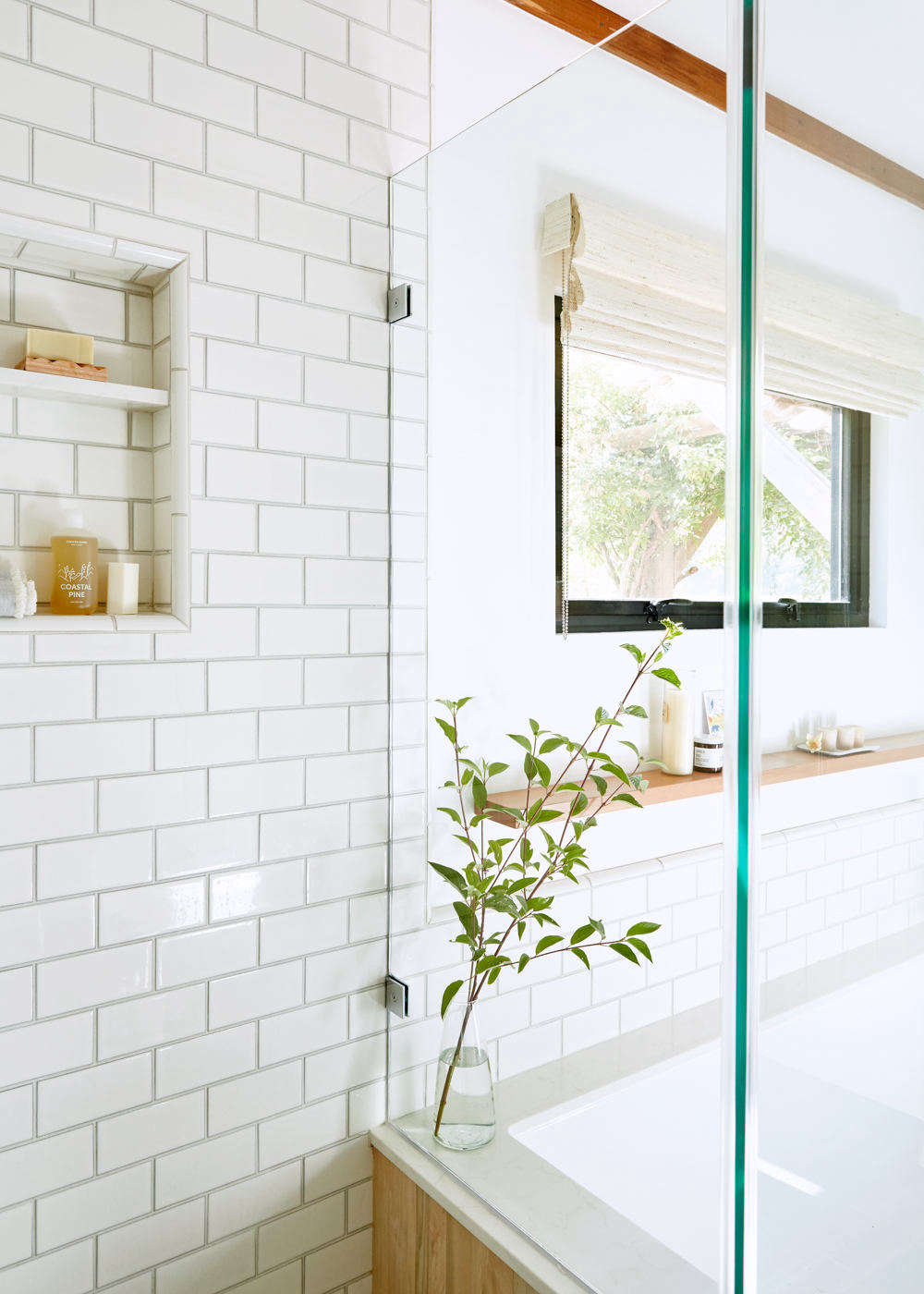 To bring more light into the bathroom, Lois installed a custom steel window from Bonelli, a San Francisco window manufacturer. The Roman shade is from The Shade Store.
