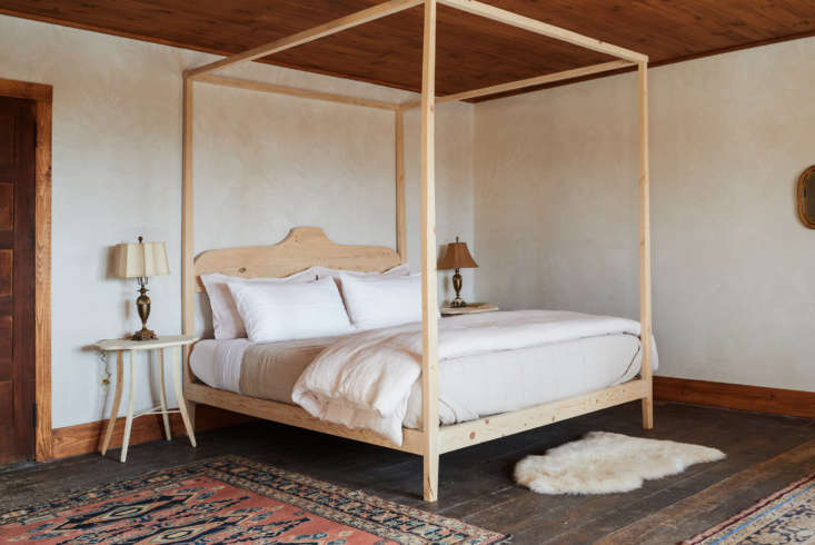 Upstairs, the generous master or bridal suite features a custom-made bed by Percy.