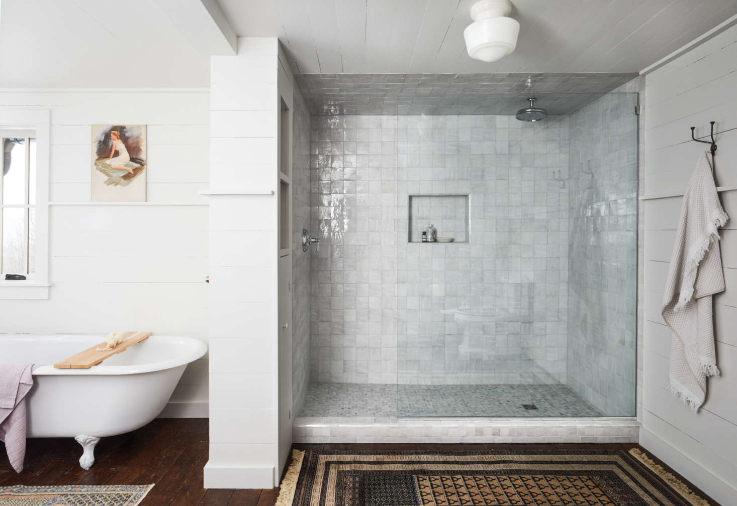 The master bathroom features a generous shower lined in Moroccan tile from Cle&#8