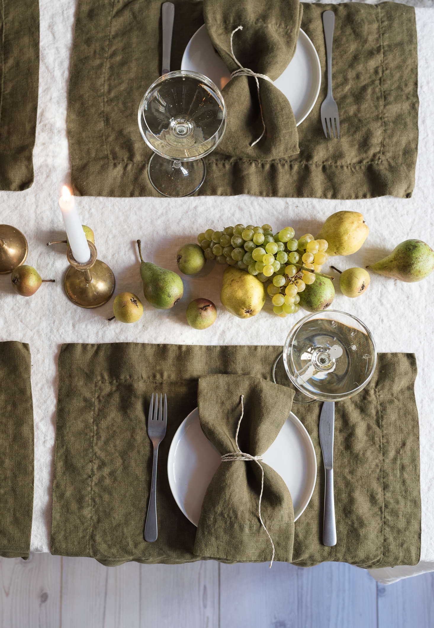 Fruit becomes a jewel-toned centerpiece when laid artfully down the center of the table.