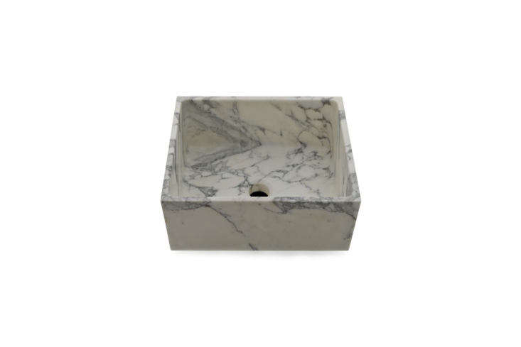 Although not a full-size kitchen sink, the Waterworks R.W. Atlas Stone Apron Bar Sink is worth a mention for its clean, boxy shape and Arabescato marble; $