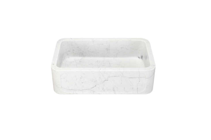 The 30-Inch Polished Marble Farmhouse Sink with a recessed apron in Carrara marble is $loading=