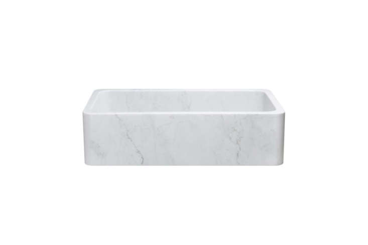 The Stone Farmhouse Sink in White Carrara Marble measures 36 inches with a honed finish (to neutralize the effects of acidic foods); $
