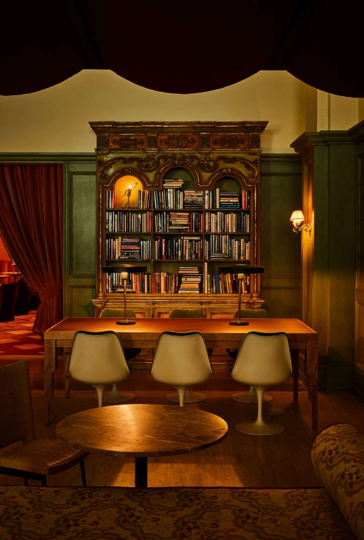 An heirloom bookcase meets modern chairs.