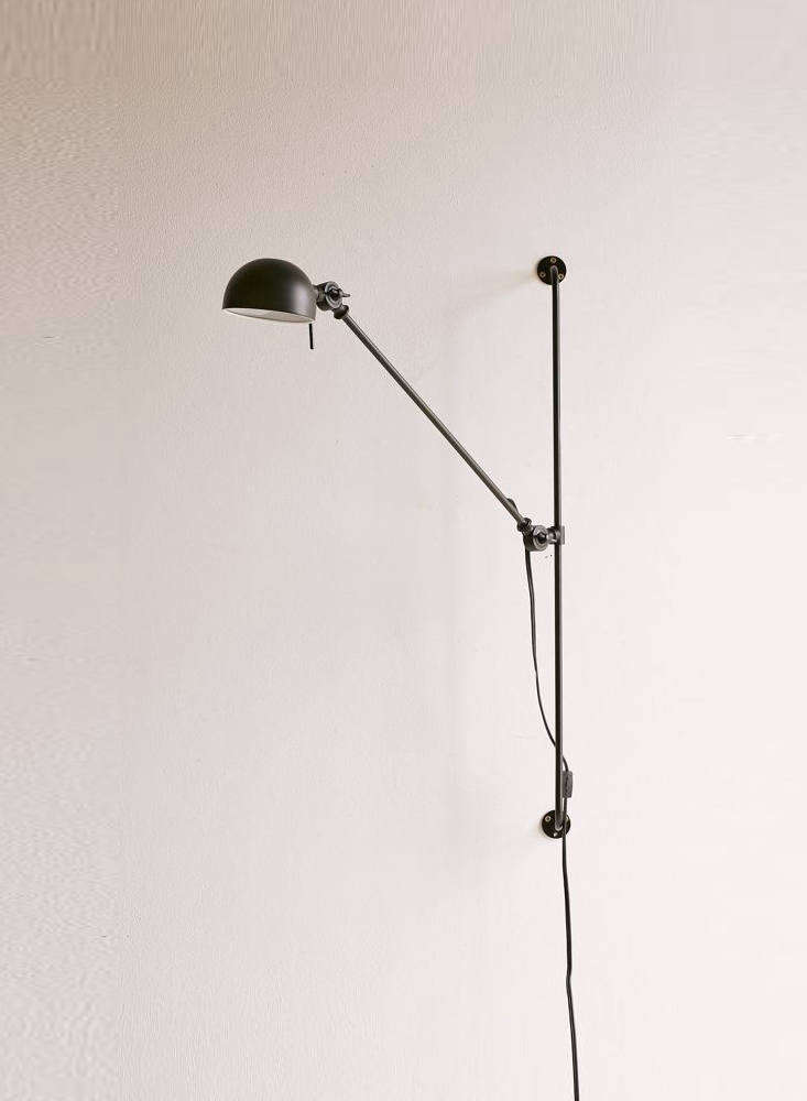 The Simon Adjustable Sconce, also made of black steel and &#8