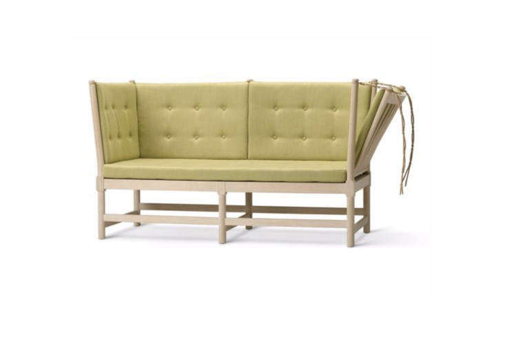 Børge Mogensen designed theSpoke Back Sofain 45 as an English daybed and French chaise combo, thanks to the hinged side. It's made from a solid oak frame and available in a range of upholstery options including leather, stripes, and woven plaid. Available in the US for $9,