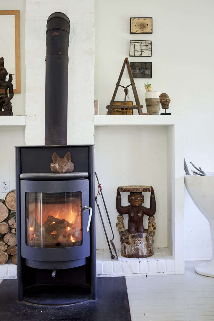 Jonathan added cube-shaped log holders on either side of the stove: &#8