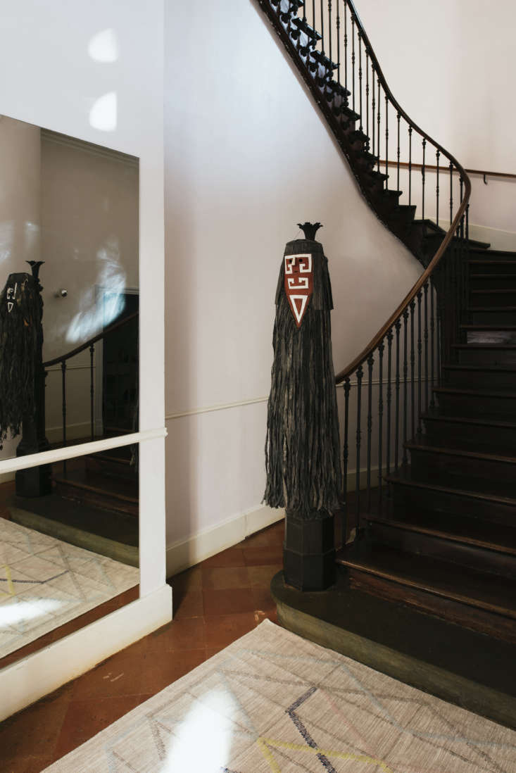 Hanging from the banister is a Tamok mask. &#8