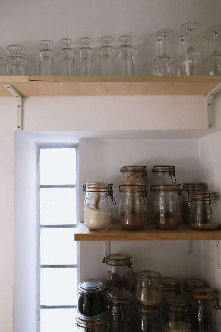 La Vie en Rose Inside a Costumiers Dreamlike DIY Maison in France Kitchen with Open Shelves in Celine Sathal's Remodeled Country House in France, Photo by Eefje de Coninck