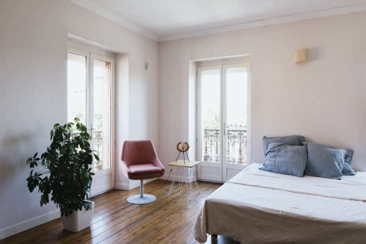 La Vie en Rose Inside a Costumiers Dreamlike DIY Maison in France The bedrooms are fitted simply, with handmade linens and an unexpected lamp or chair.