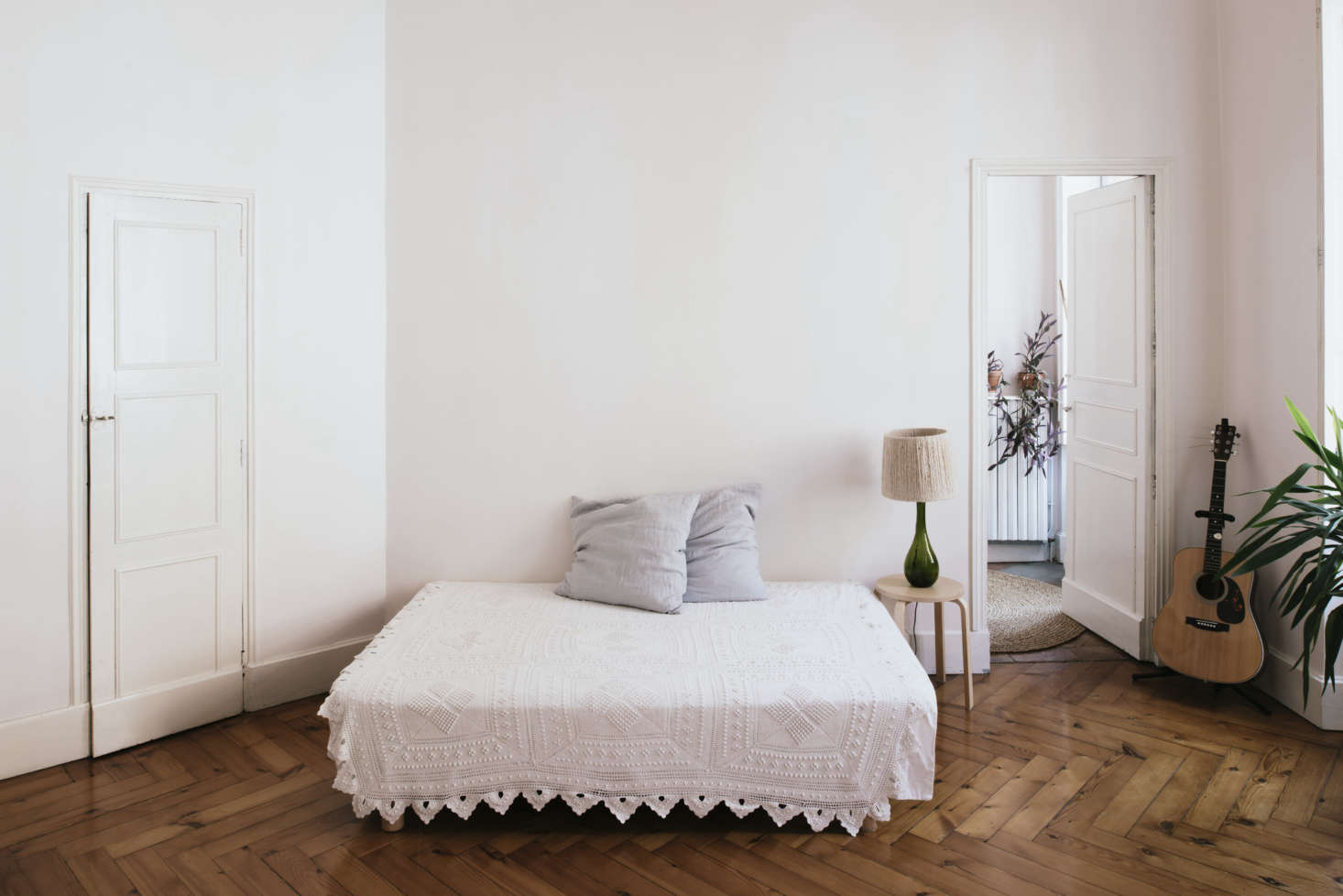 The sparsely fitted bedroom. &#8